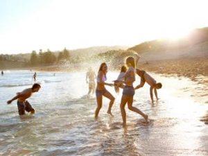 friends-vacation-beach-ocean.jpg.rend.tccom.336.252