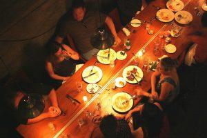 people-together-shraring-diner-friends