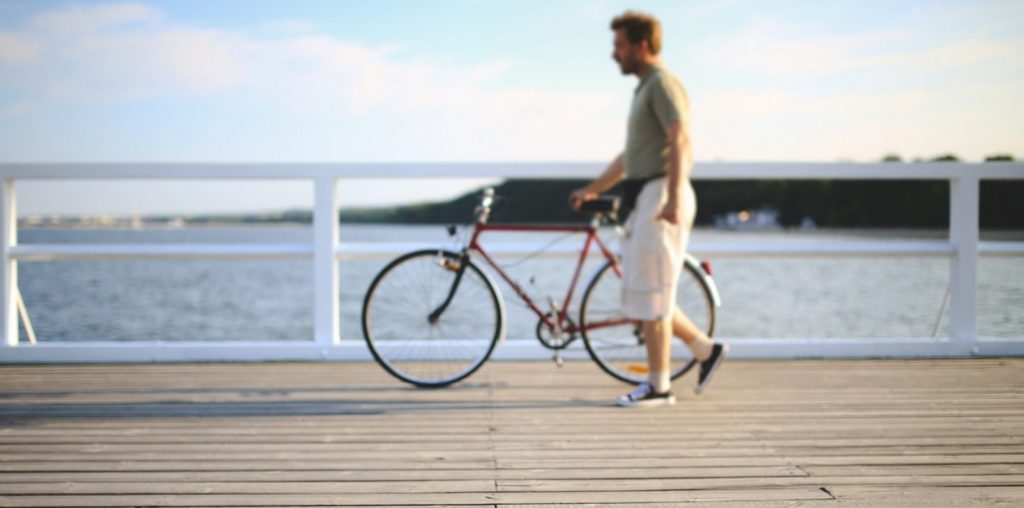 2-man-with-bicycle-on-pier